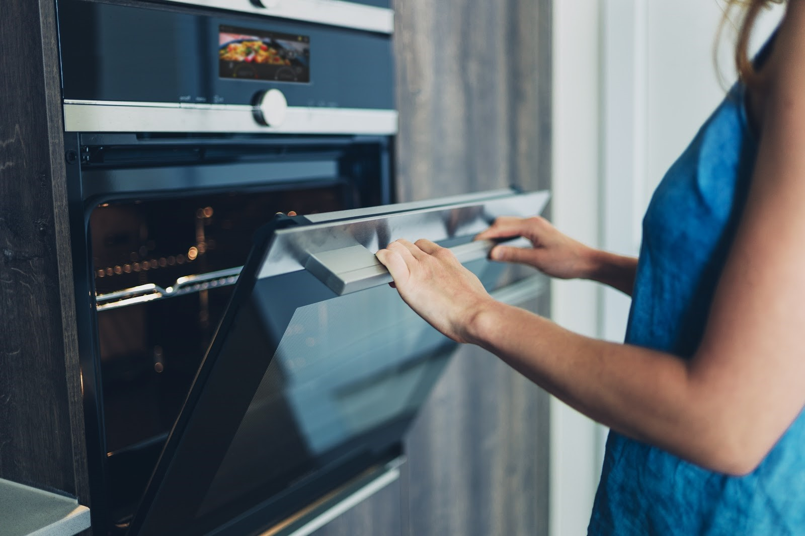 woman using oven with voice activation